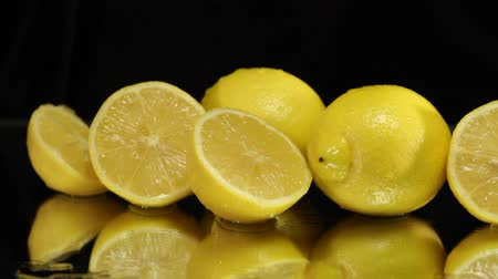 calcário : Wet Lemons on Black with Slider Stock Footage