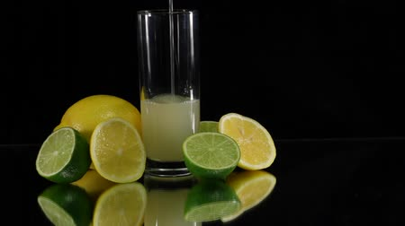 lemoniada : Pouring Citrus Juice on Black