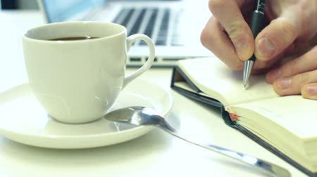 coffe : Businessman Drinking Coffee in Office and Making Notes