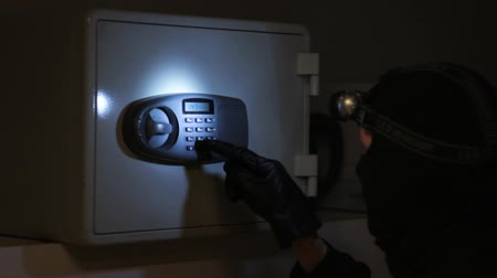 przestępca : Burglar in the Office with Torch Light Forcing Safe Box Lock