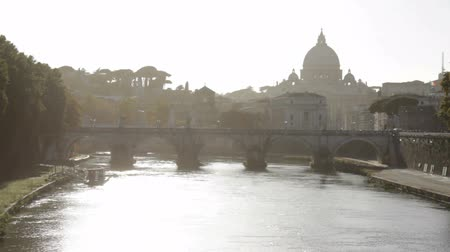 watykan : Hazy view of St. Peters Basilica from the bank of the river.