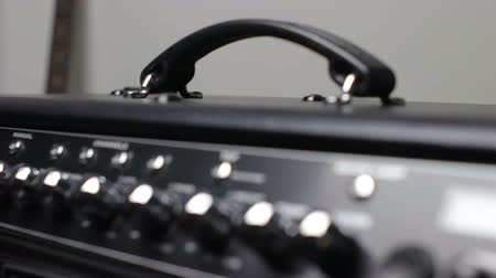 dengeleme : Focus on electric guitar amplifier in recording studio close up