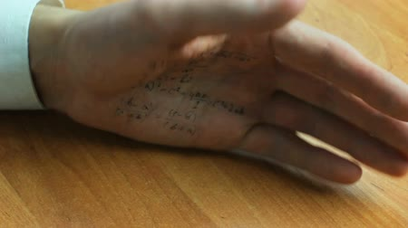 plagiarism : Hand of cheating student at mathematics examination or lecture Stock Footage