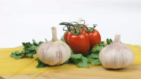 olivy : Spaghetti Ingredients with Tomatoes and Garlic on White