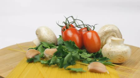 Spaghetti Ingredients with Agaricus Mushrooms on White