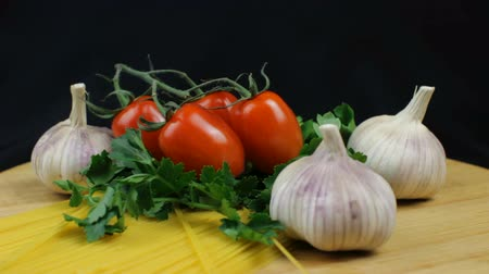 Spaghetti Ingredients with Tomatoes and Garlic on Black