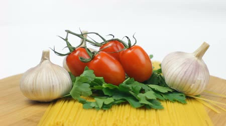 Spaghetti Ingredients with Tomatoes and Garlic on White