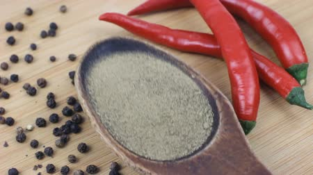 Varieties of chili and spices pepper on wooden plate