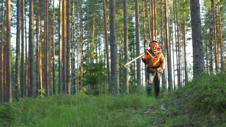 Lumberjack walking home after work in the forest