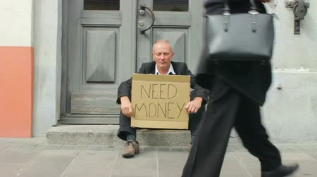 Destitute Bankrupt Businessman with Need Money Sign in the Street