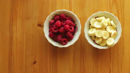 Fresh Healthy Fruits and Berries in Bowls on wooden Table Top View