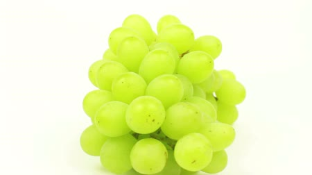 Green Grapes Rotating on White