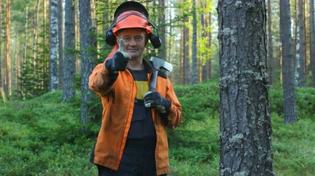 Lumberjack with an Ax Showing Thumbs Up in the Forest