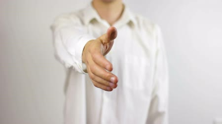Man in White Shirt Extending Hand for a Handshake Frontal View