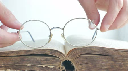 Old Glasses Placed on Vintage Book