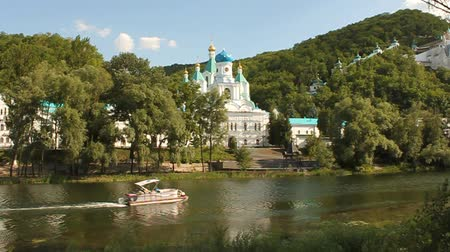 Holy Assumption Monastery and powerboat Stock Footage
