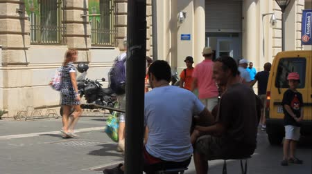 HERAKLION, CRETE, GREECE - JULY 30, 2013: Street musicians playing on the street leading to the harbor
