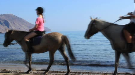 GEORGIOUPOLIS, CRETE, GREECE - JULY 31, 2013: Unidentified riders on horses on the beach. Horseback riding in Crete one of the favorite pastimes of vacationers