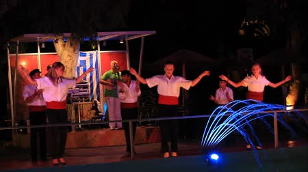 GEORGIOUPOLIS, CRETE, GREECE - JULY 30, 2013: Evening of Greek music in the Corissia Princess hotels cafe on the waterfront Georgioupolis