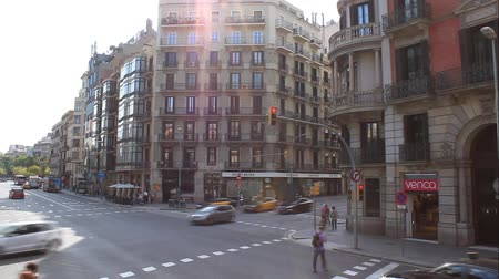 BARCELONA, SPAIN - JULY 13, 2013: On the streets of Barcelona always busy traffic