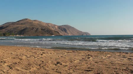 Small waves, sandy beach. Crete, Georgioupolis