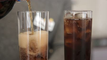 nightcap : The barman pours soda into a glass of ice Stock Footage