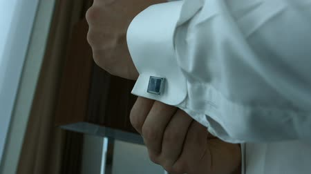 gentleman : Groom wears stylish cufflinks close up
