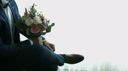 Groom with a bouquet of flowers Стоковые видеозаписи
