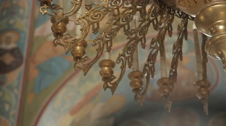 Gilded chandelier in the church Stock Footage