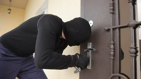 The thief breaks the door lock