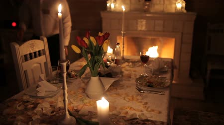 誕生日 : A loving couple dines by candlelight near the fireplace
