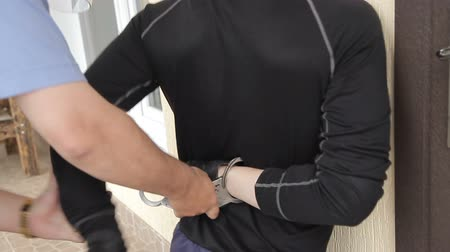 Police handcuffs a thief Stock Footage