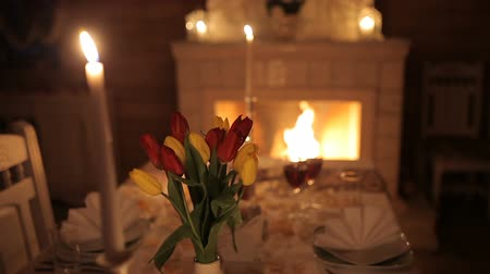 отель : A loving couple dines by candlelight near the fireplace