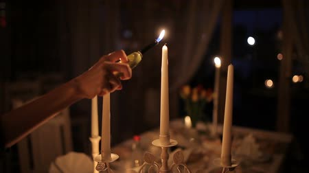 plamen : A loving couple dines by candlelight near the fireplace