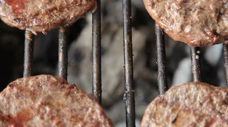 ribs : Grilled meat sausages on charcoal grill Stock Footage