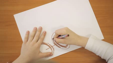 coloured : boy draws car wheels with pencil on paper Stock Footage