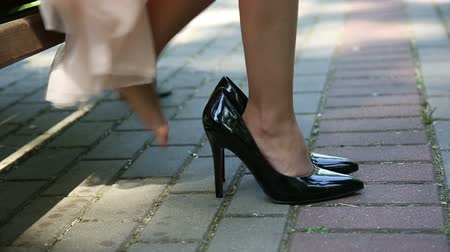 jest : Little girl puts on big moms shoes