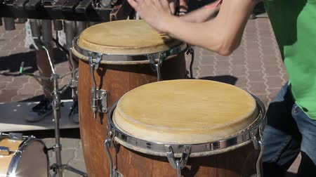 ispanico : The street drummer plays the Conga drums