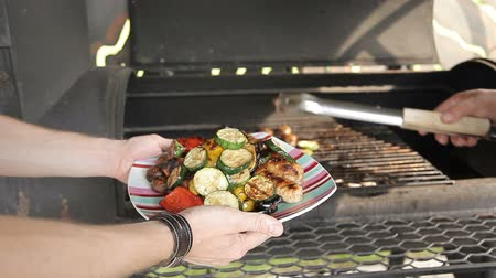 kabab : Grilling vegetables on a outdoor barbecue. Vegetables are grilled on charcoal. Vegetables are roasting on the grill