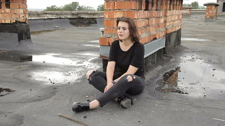 body building : Teen girl in depression sitting on the roof of a building