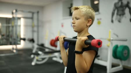 omini : The boy is training in the gym