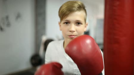 kop : Boy boxing with gloves in the gym