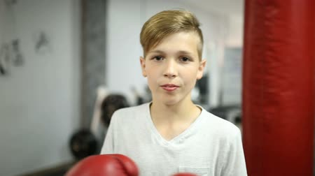 perverso : Boy in red boxing gloves beats