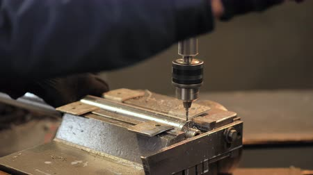 rozsdamentes : Worker make holes in the details with the help of a drilling machine. The concept of auto parts production Stock mozgókép