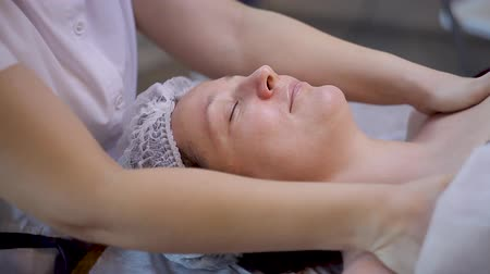 closed : Beautiful Young Woman Relaxing Female Receiving Facial Body Massage Beauty Spa.