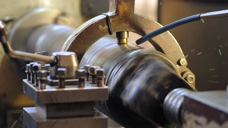 fitter : Turning lathe. Facing operation of a metal blank on turning machine with cutting tool.