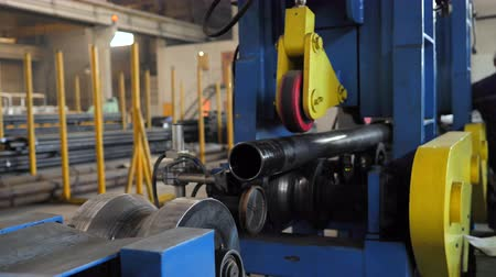 rozsdamentes : Pipe production line. Production of metal pipes factory. The process of manufacturing metal pipes on the machine