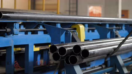 rozsdamentes : Metal pipe fall from production line. Pipe processing at the factory. Pipe on conveyor belt at factory. Production process of pipe in metal industry