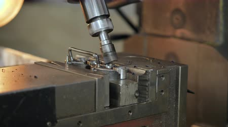 cortador : Drilling steel, slow motion. The boring machine processes metal, cuts a form.
