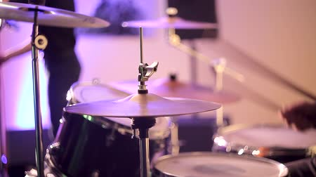 cymbals : The drummer plays chopsticks on the drums. Beats drum sticks on the plates and drum set. A jazz orchestra drummer plays chopsticks on drums. Stock Footage